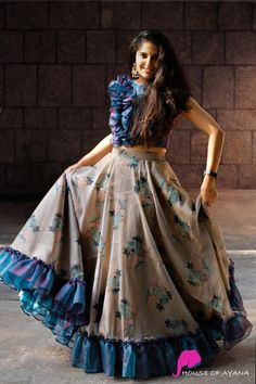 Product details: Skirt: Organza silk, Floral PrintedTop: Organza silk A fun and playful single sided ruffle crop top matched with a 10 mtr floral skirt completed with similar ruffle pleating. Party Wear Indian Dresses, Designer Party Wear Dresses, Indian Gowns Dresses, Indian Fashion Dresses, Dress Indian Style, Indian Designer Outfits, Girls Fashion Clothes, Wedding Dresses, Stylish Dresses For Girls