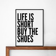 life is short buy the shoes quote poster print by sinansaydik