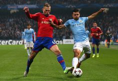 Sergio Agüero competes with Aleksei Berezutski during the UEFA Champions League group D match between Manchester City and CSKA Moscow at Etihad Stadium on November 5, 2013 in Manchester, England.