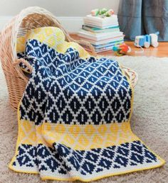 Create this vibrant Tunisian Crochet baby blanket using the interesting technique of stranded colorwork. The Bright Strands Blanket works two colors in any given row; the working color is pulled up to match the geometric pattern, while the unused color is Crochet Afghans, Tunisian Crochet Blanket, Tunisian Crochet Patterns, Tapestry Crochet, Baby Blanket Crochet, Crochet Baby, Knit Crochet, Crochet Blankets, Crochet Crafts