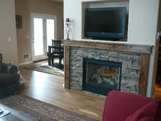 Propane fireplace--double-sided, facing family room and eat-in kitchen