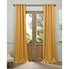 Exclusive Fabrics Marigold Grommet Blackout Thermal Curtain Panel Pair (50Wx108L), Gold, Size 50 x 108 (Polyester, Solid)