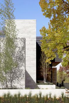 Modern home, landscaping, exterior tile wall, Wisconsin Modern Riverfront project by dSPACE Studio, Ltd. AIA