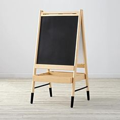 Shop Artsy Easel. As soon as you stand in front of this wooden art easel, you've got to ask yourself one question: Are you feeling artsy?
