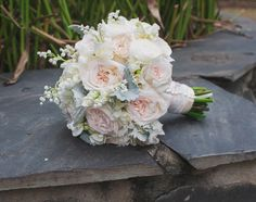 "Blush Bouquet of white o""hara roses, white peonies, dusty miller, and lily of the valley"
