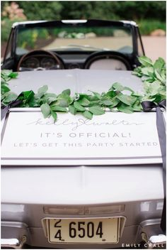 Iowa wedding, vintage getaway car, car sign and floral garland