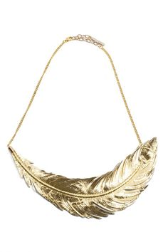 Gilded feather statement necklace.