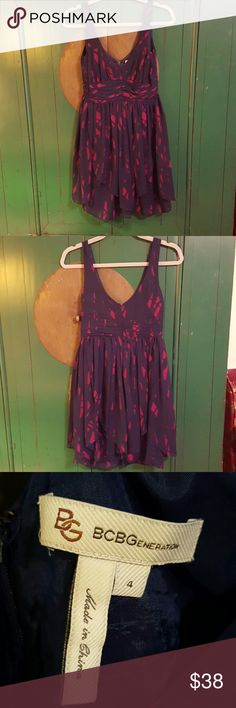 Beautiful Party Dress. BCBGENERATION size 4 This pretty, flowy dress has a back zipper, is fully lined and has multiple layers of chiffon to give it great movement. Non smoking household.  I don't find anything wrong with this fun dress! BCBGeneration Dresses Mini