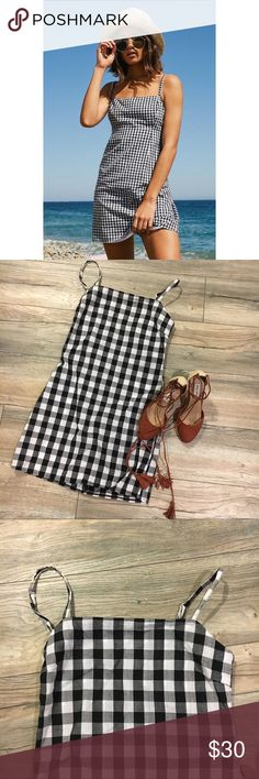 Gingham black and white dress Stunning summer dress! Adjustable straps and toes behind the back. Zips up for closure. This dress is a boutique item and is NWOT. No flaws. Dresses Mini