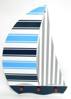Features:  -Comes with 3 hooks for hanging space.  -Wall mount.  Product Type: -Hanging art.  Theme: -Nautical.  Color: -Navy/Blue/Gray.  Gender: -Neutral.  Life Stage: -Kid.  Pattern: -Stripe. Dimens