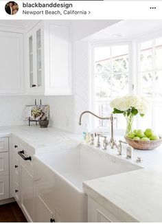 A gorgeous farmhouse sink is paired with an antique polished nickel faucet mounted in front of a bay window to a honed white marble countertop accenting white cabinets adorning oil rubbed bronze hardware. - My Interior Design Ideas Kitchen Cabinets Decor, Cabinet Decor, Cabinet Ideas, Cabinet Design, Oak Cabinets, Cabinet Makeover, Kitchen Walls, Antique Cabinets, Kitchen Hardware