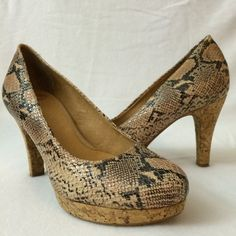 """Nurture """"Kira"""" Leather snakeskin pattern pumps Lovely snake pattern leather pumps. These versatile heels can be dressy or business. Leather upper. Leather lining. Man made sole. Made in Dominican Republic.  Super cushioning inside makes these heels very comfortable to wear. 3.5-inch heel and anchored by a 0.75-inch platform.  Barely used worn only a handful of times. Nurture Shoes Platforms"""