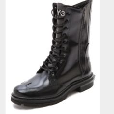 """Y-3 combat boots Y-3 black leather """"Jones II"""" combat boots. Oxford detail on front with lace up front and side zip. Worn two times, comes with box, dustbag, and extra laces. Y-3 logo on back heel. """"Y-3"""" metallic 3-D logo on tongue. Squared detail at mid-sole heel(pic 4) with """"Yohji Yamamoto"""" written on it. Awesome boots. Y-3 Shoes Combat & Moto Boots"""