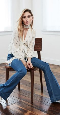 Who made Olivia Palermo's print top and blue flared jeans?