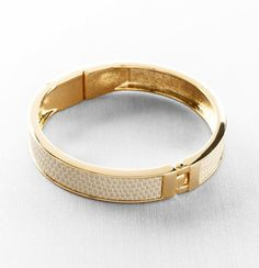 I could see this stacked with a few other gold and cream colored bangles.