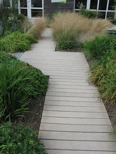 These wood walkway ideas may be exactly what you need to get your plans going in redoing your outdoor area. Either the wood walkway leads to the. Wooden Pathway, Wood Walkway, Wooden Garden, Wood Path, Stone Walkway, Garden Structures, Garden Paths, Lawn And Garden, Herb Garden