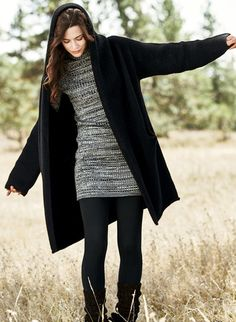A sumptuous embrace of plush, felted alpaca (93%) and nylon (7%), this minimalist coat design is the perfect snuggle-up layer for wintry days. Knit easy and oversized, with a generous hood, drop shoulders, wide sleeves and pockets. The voluminous overlap requires no closure, and we've left it intentionally unlined so you can feel the fiber's softness.