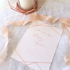 Save the Date in style. Spring colours of pale dogwood pink calligraphy with modern,geometric shapes of copper