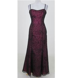 A beautiful evening dress from Morgan & Co.   This fully lined dress features delicate black sheer fabric in sparkly velvet over a pink sweetheart bodice trimmed with shiny beads and has sleek narrow straps.  It closes at the side with a concealed zip and has
