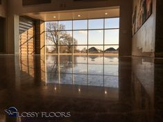 Stained concrete from Glossy Floors are some of the most beautiful additions you can make to your home or place of business. With each floor being individually unique, there's a style and color to match any home or business decor. Just like the floor to the right, stained concrete can be beautifully designed with a multitude of colors. Whether you're looking for a brown and black combination or even a combination of orange, yellow, blue, green and purple, Glossy Floors has the stained con...