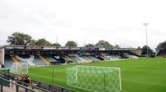Huish Park - Yeovil Town. Three sheds and a roofless away end. Getting soaked is an inevitability. Great boozy day out in summer.