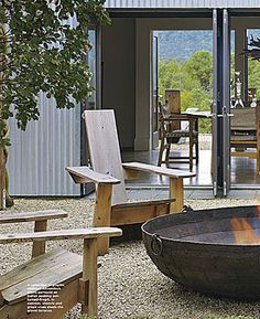 outdoor space by erin martin, love the bowl fire pit, but the chairs are the focal point. really unique