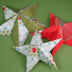 I started with this tutorial but soon realized these are much more easily made like paper snowflakes instead of measuring and marking over and over. After a few folds I only had to make one cut and voila! 3d paper stars. Make Paper Stars from Lost Button Studio