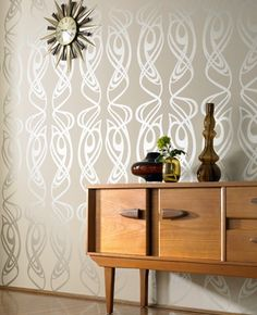 I really love Graham & Brown for wallpapers.  One of the only stores carrying amazing (and tasteful) Art Deco inspired wallpapers.  This design--Diva Beige--is one of my favorites.