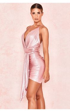 'Ciara' has a languid liquidity borne from the slinky metallic fabric and the sexily draped shapes. The front has a wrap detail and ruched draped skirt and the back dips daringly low in the back with cross spaghetti straps. Sexy Dresses, Short Sleeve Dresses, Prom Dresses, Bandage Dresses, Metallic Pink, Metallic Dress, Sparkly Outfits, Metallic Jumpsuits, Dress Skirt