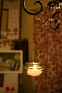 not sure what to do with the glass yankee candle lids...but can't stand to through them away...make hanging lanterns!! <3