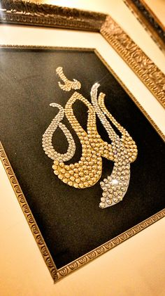 """""""Allah."""" Swarovski crystal God in arabic calligraphy in silver and gold crystals"""
