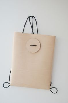 BUTTON BACKPACK This elegant minimalist #backpack is made of natural vegetable tanned leather.