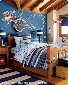 Pottery Barn Kid's airplane themed bedroom a few years ago.    I love the wall behind the bed. I'd love to do one with a map of Michigan on it showing all the lakes.