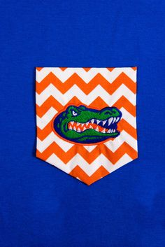 Short sleeved T-shirt with chevron pocket and University of Florida Embroidery. Perfect for the Florida Gator Fans!