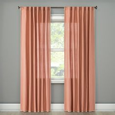 Let in a lot or a little light with the Stitched Edge Curtain Panel from Threshold. This drapery panel is a solid color with decorative stitching along the edges.