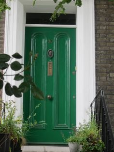 green front door10 Colorful Front Doors Thatll Make You Want to Bust Out the