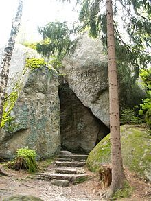 The Luisenburg Rock Labyrinth (German: Luisenburg-Felsenlabyrinth) is a felsenmeer made of granite blocks several metres across and is part of the Großes Labyrinth Nature Reserve near Wunsiedel in Germany. For a long time its formation was believed to have been caused by natural disasters such as earthquakes. Today it is known that processes such as weathering and erosion over a long period are much more likely to have been responsible for the formation of the rock labyrinth