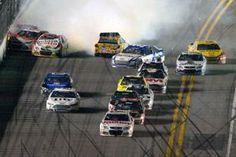Dale Earnhardt Jr. (88) escapes a final lap wreck and…
