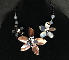 Glass, crystal and stone three flower brown tones necklace set $35.  Sold everywhere for $90 and up. Comes in other colors at www.sisters5and10.com