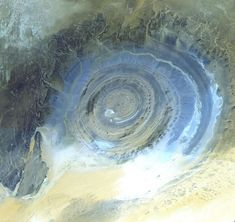 The Richat Structure.  A circular feature in the Sahara desert that is ~30 miles wide.  Not an impact crater nor a volcano.