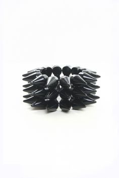 The smaller version of our Big Spike Bracelet is great for stacking with all your faves!PlasticStretchy FitImported