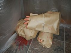 Another Dexter touch.dollar store hands wrapped in paper. Halloween Cubicle, Teen Halloween Party, Clown Party, Halloween Office, Halloween Birthday, Fall Halloween, Halloween 2019, Dexter Halloween, Asylum Halloween
