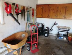 "Garage and Grill items including Craftsman 5.0 24"" snow blower, Briggs and Stratton 500 series 158 cc 24"" mulching gas lawnmower, Brinkman gas grill 4 burners work side burner does not 48""Tx54""Wx20""D, hand truck, True Temper large wheel barrow, Black and Decker Workmate 425 workbench,"