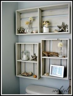 Beach / ocean / nautical themed bathroom. Buy $10 crates from Hobby Lobby or a craft store, paint & distress. Voila! Lovely shelves! This would be great for toilet paper or rolled towel storage as well.
