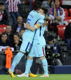 Barcelona's Brazilian midfielder Paulinho (L) is congratulated by teammate Argentinian forward Lionel Messi after scoring his team's second goal during the Spanish league football match Athletic Club Bilbao vs FC Barcelona at the San Mames stadium in Bilbao on October 28, 2017.  / AFP PHOTO / ANDER GILLENEA