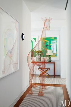 A towering giraffe sculpture by Benedetta Mori Ubaldini punctuates a hallway in a prewar Manhattan apartment renovated by Shelton, Mindel & Associates. Read on for more ideas on how to decorate with sculptures shaped like animals.