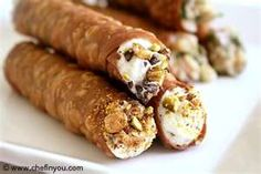 Italian Cannoli shells with sweet and savory filling ...