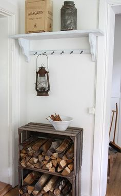 Country Wood Rack.  wooden crates used for wood rack next to fireplace/wood stove