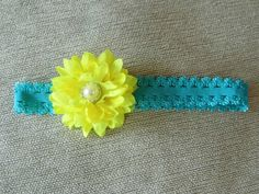 Teal elastic headband with bright yellow pearl flower