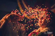 colored rain. South Indian wedding, Bangalore. #bangaloreweddingphotographer #bestweddingphotos #weddingphotographerbangalore #indianweddingrituals